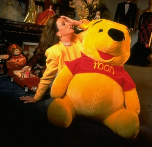 Mattel CEO Jill Barad w. giant stuffed bear in likeness of Winne-the-Pooh.